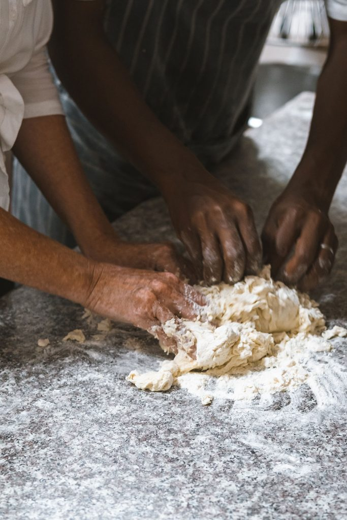 Earn your keep by kneading bread in the kitchen
